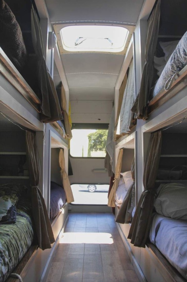 8 students convert old school bus into an amazing diy for Interieur de camping car