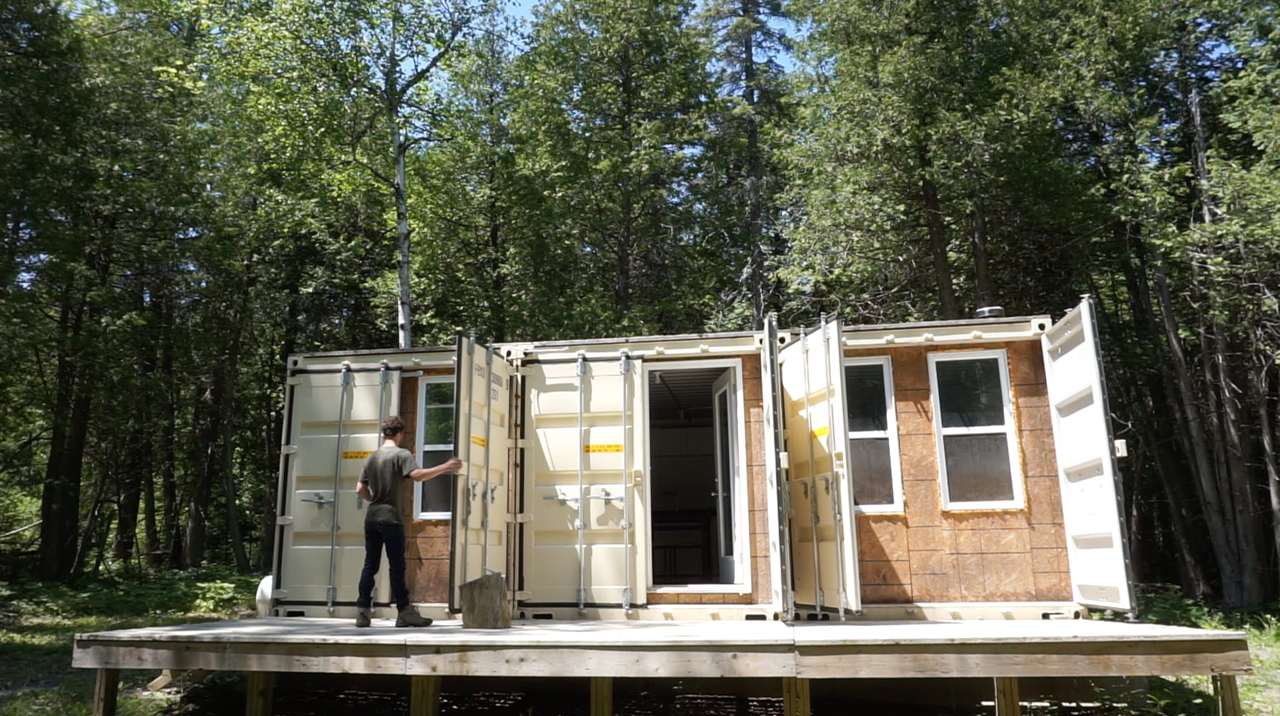 Young entrepreneur living off grid in a self built shipping container home video tour - Off the grid shipping container homes ...