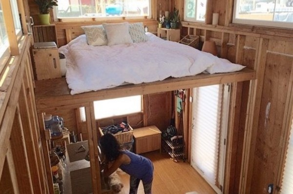 Man building a cheap diy 200 sq ft tiny home on wheels for Cheapest way to build a building