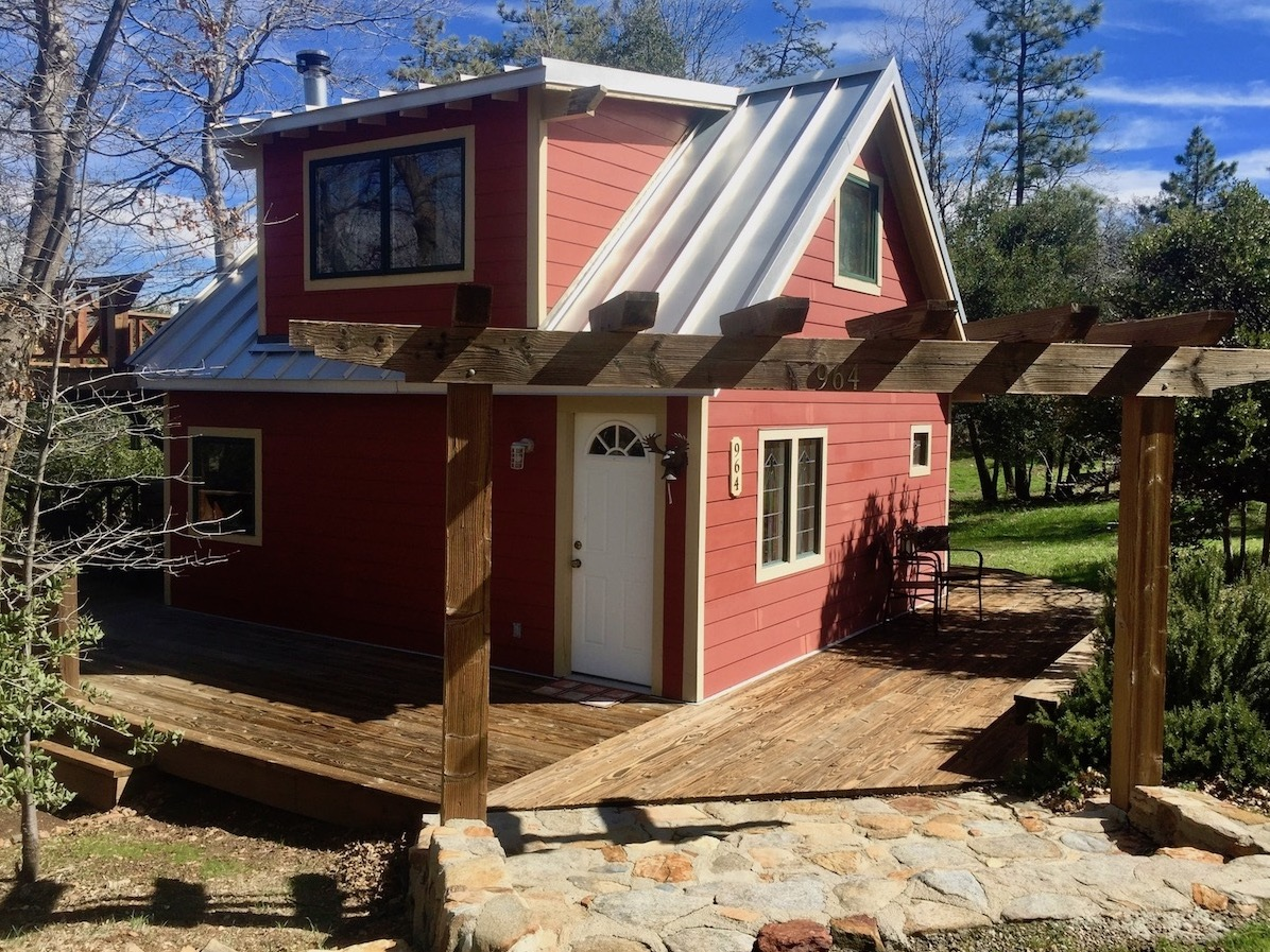 Little red cabin with a metal roof in julian california for Metal cabins homes