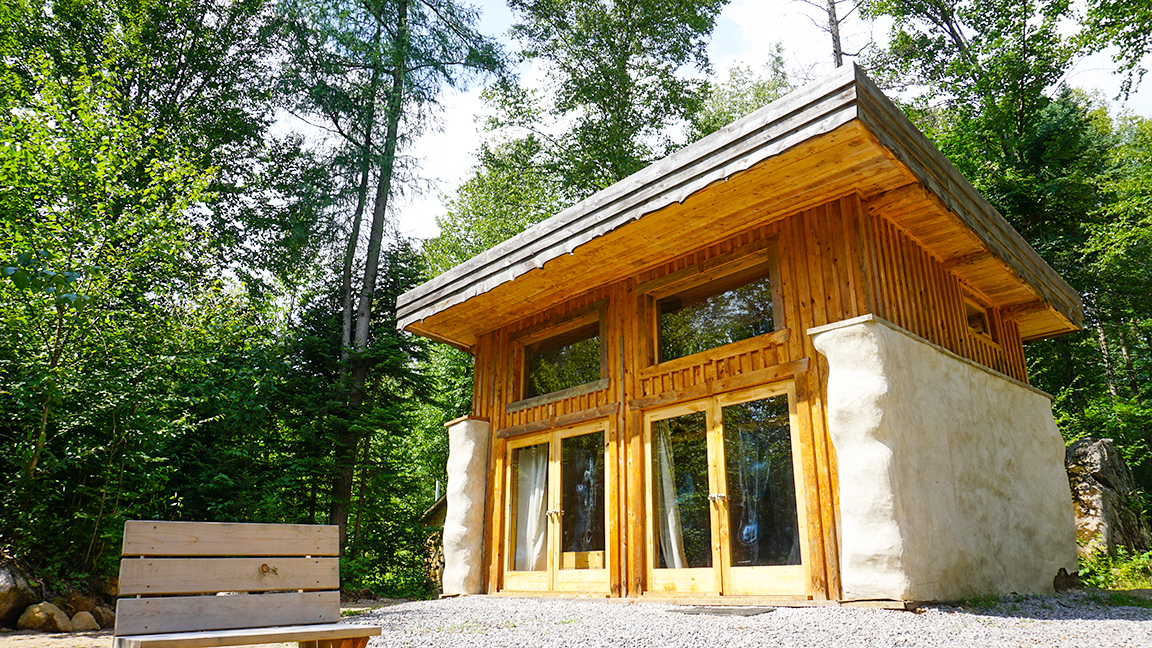 Tiny straw bale cabin with passive solar green roof video for Small straw bale house plans