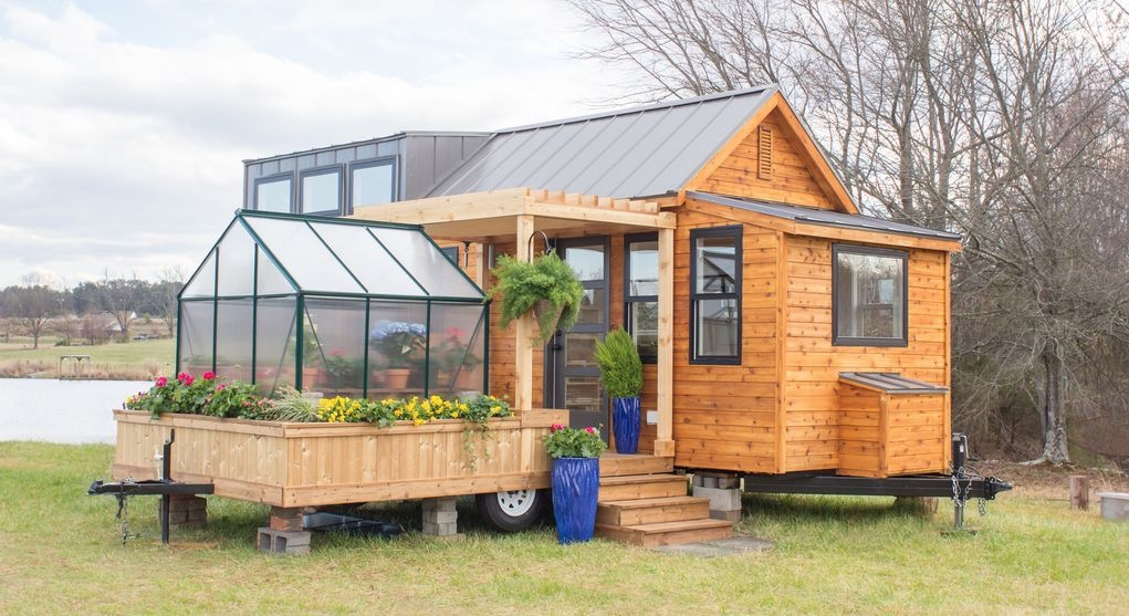 Tiny Home On Wheels With Adjoining Patio And Green House On Wheels Currently At Lakewalk Tiny