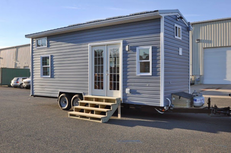 Tiny house building company 39 s solar powered cottage on wheels for House building companies