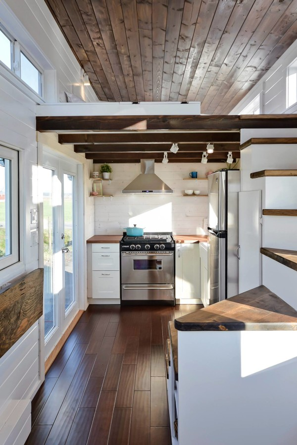 Tiny house on wheels w big kitchen and double sink vanity for Small house plans with big kitchens