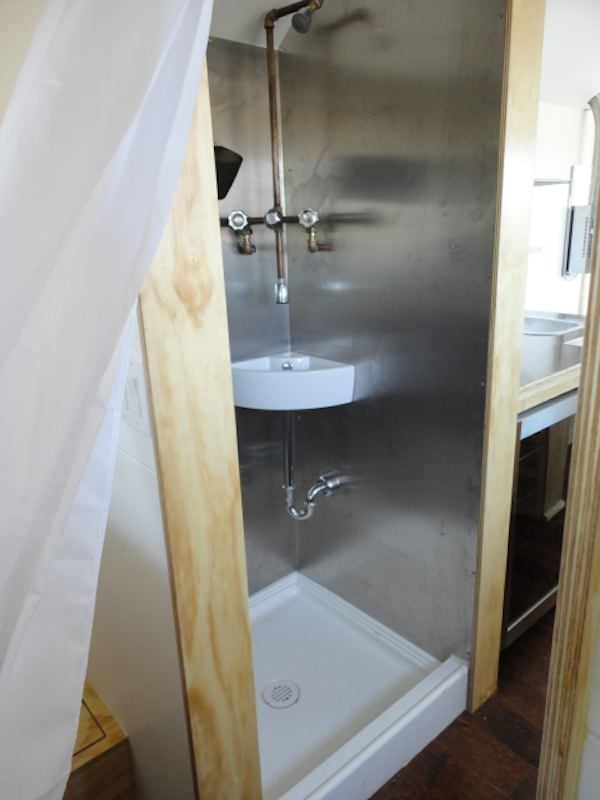 bathroom shower and sink in tiny house   Meet this Couple Living in a 204 Square Foot Tiny House