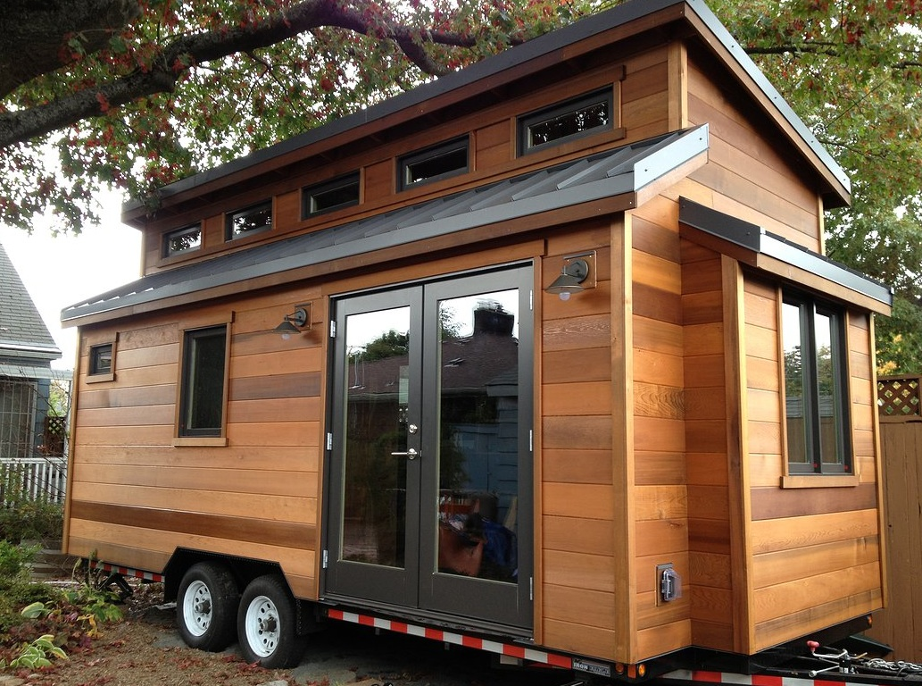 the bunk box tiny house uses unique construction techniques to create an extra spacious interior and a cool industrial chic feel youll love the extra head - Tiny House Trailer Interior