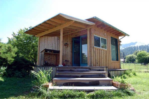 Couple build diy reclaimed off grid tiny cabin for 7k for Small cottages to build
