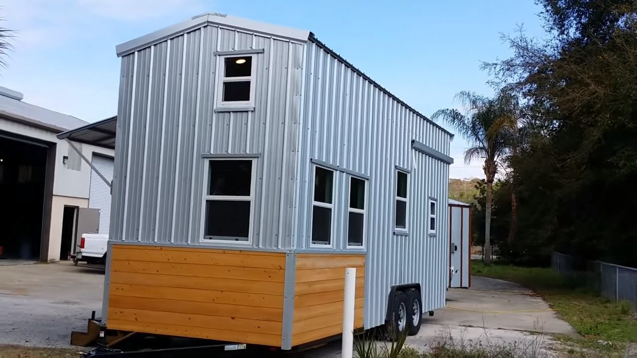 custom tiny house on wheels with a split level floor plan