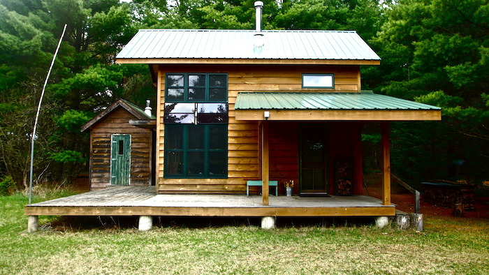 Diy hand built off grid tiny cabin for Off the grid home design plans