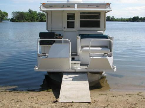 houseboat docked   Trailerable Houseboat For Sale