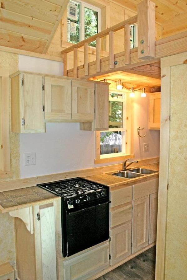 Tiny house with a flip up porch for Small house kitchen designs