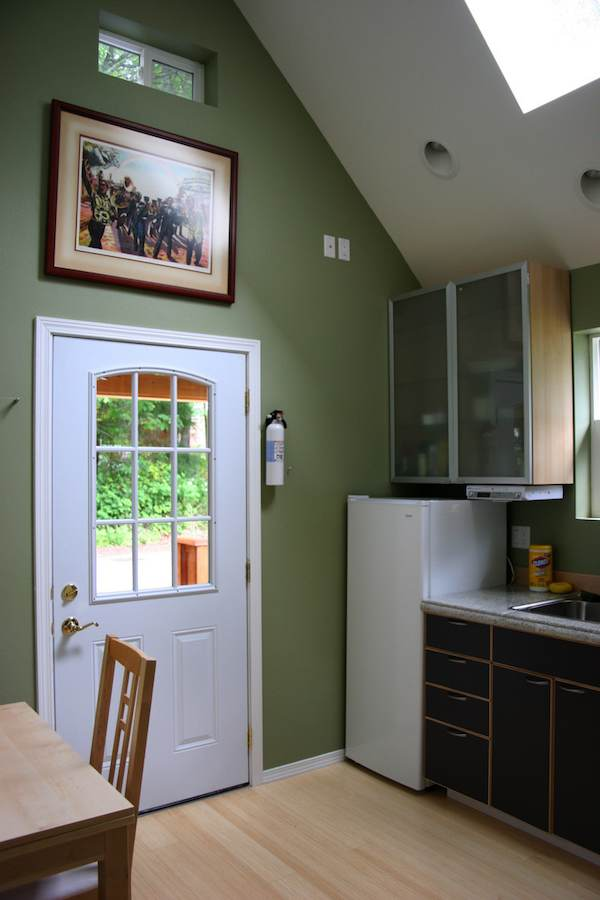 Kitchenette and Table inside Mulfinger Tiny House after you walk in