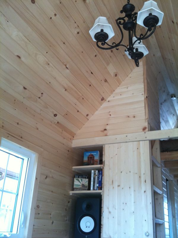 lighting and cathedral ceiling in tiny house living room   Beautiful Tumbleweed Fencl Tiny House For Sale