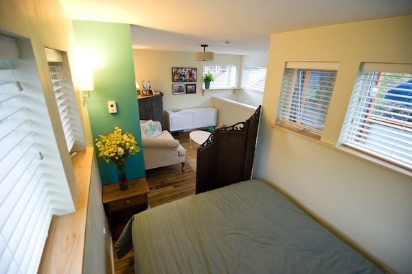 loft bedroom and living in small home   Couple Living in 500 Square Foot Small House By Smallworks Studios