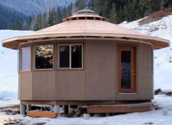 Check out Mandala Custom Homes' Round Tiny House... It's a yurt-like cabin!