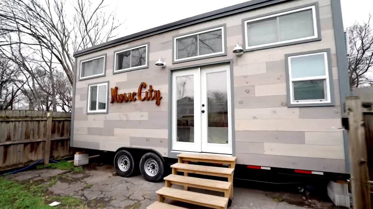 Modern tiny house on wheels with two lofts for Tiny modern apartment