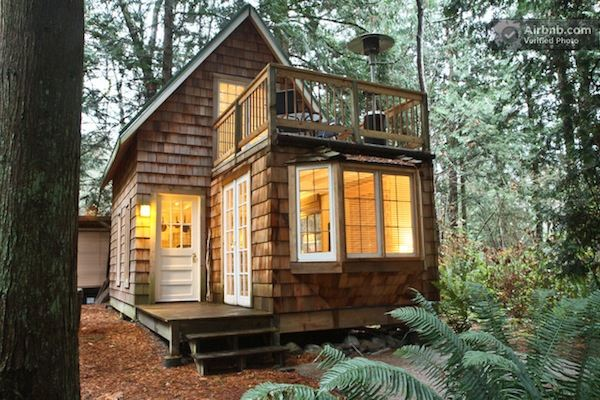 tiny cabin with upstairs balcony and small space ideas galore