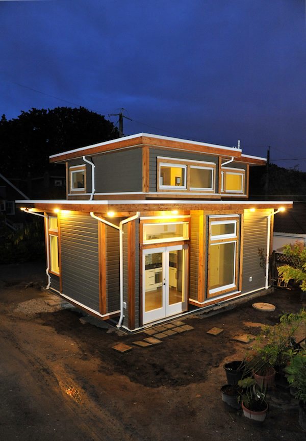 Couple living in 500 square foot small house by smallworks for 500 square foot cabin plans