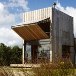 Small Beachfront Home is Elegant, Modern, and on Sleds