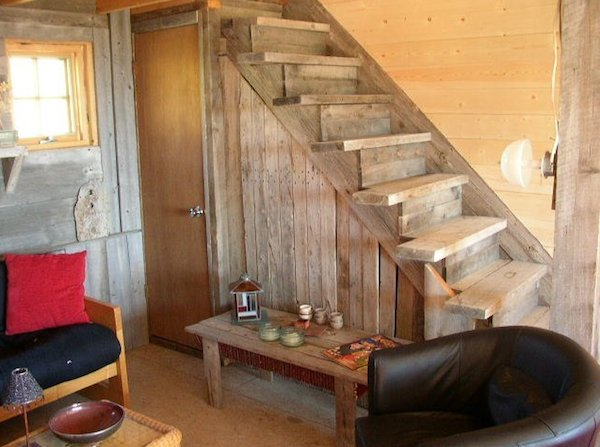 small rustic cabin living area storage   Small Rustic Cabin on 40 Acres in Colorado with Mountain Views for Sale