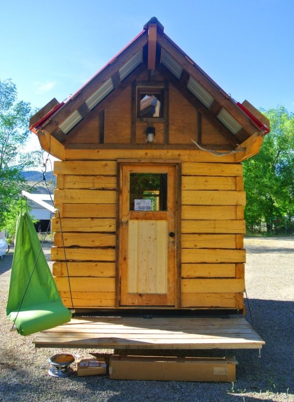 Man Builds Log Cabin Tiny House with Hinged Overhangs