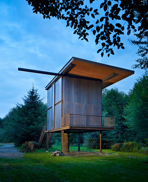 Steel clad 350 sq ft modern cabin on stilts with shutters for Elevated small house design