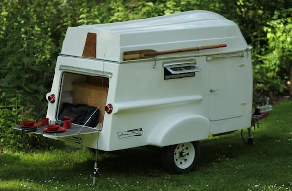 tiny light fiberglass camper doubles as boat