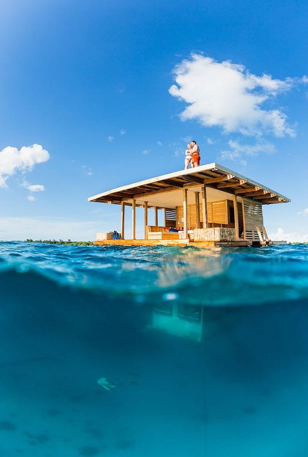 Partially Underwater Tiny Floating House with Upper Deck