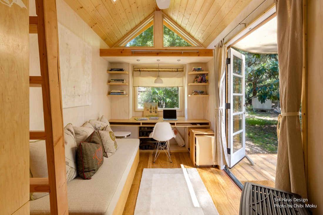 Woman Living Simply In Off Grid Tiny Home On Wheels