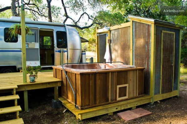 vintage airstream tiny house with deck conversion 018 600x400   Airstream Tiny House with Deck, Hot Tub, Fire Pit and Outdoor Shower