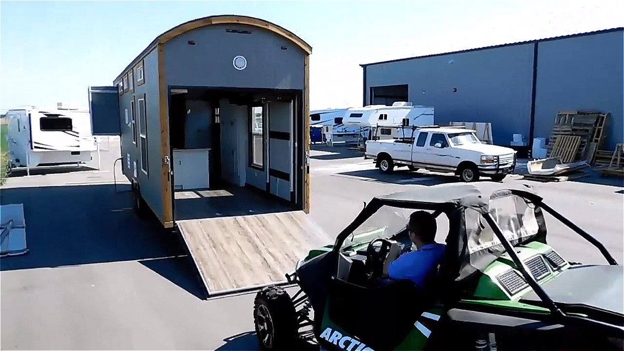 Tiny house toy hauler rv a tiny house on wheels with a for Rv garage doors for sale