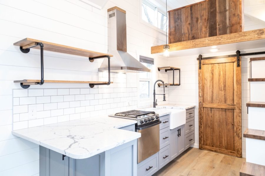 88k Farmhouse tiny house w main floor bedroom and super nice bathroom via Liberation Tiny Homes