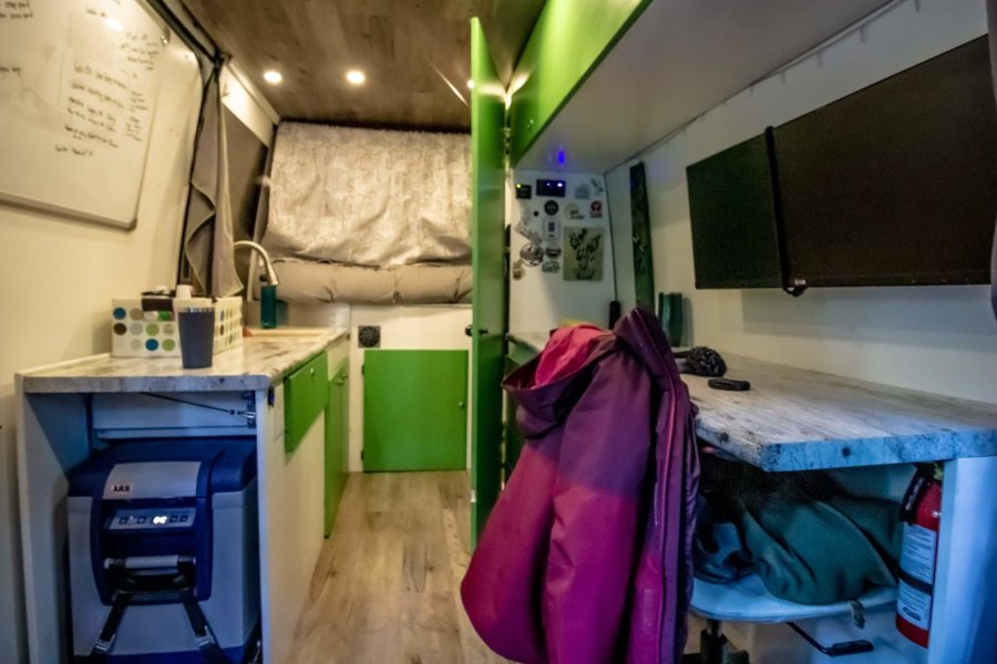 Couple Builds Their Own Off-Grid Camper Van (& Can Help You Do It Too!) 10