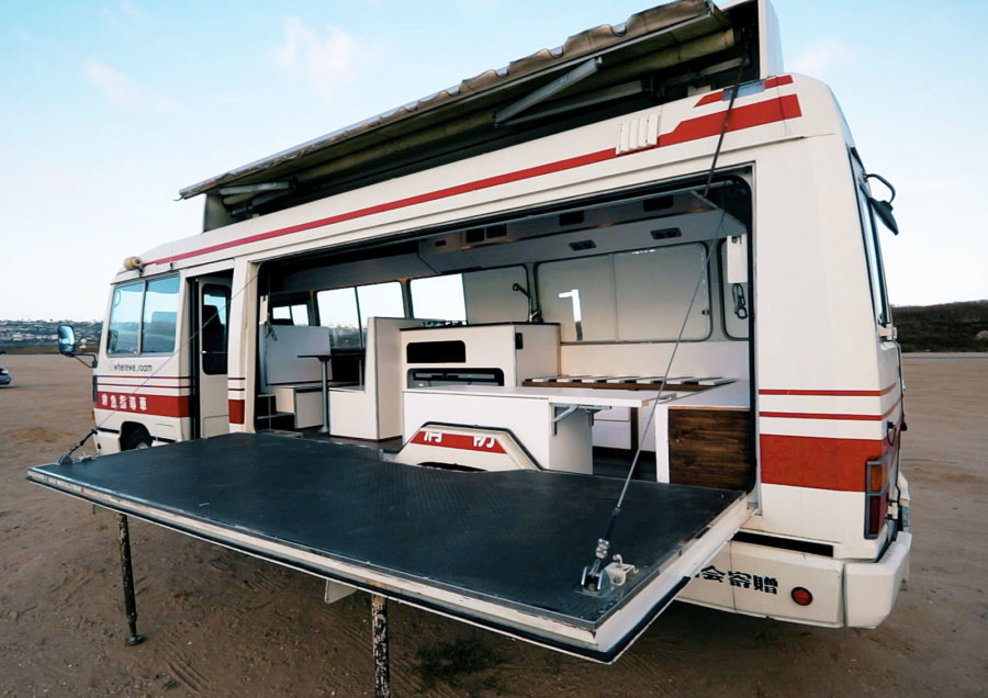 Jiro 1989 Ambulance Bus Conversion with Fold Down Performance Stage via Tiny Home Tours YouTube 001