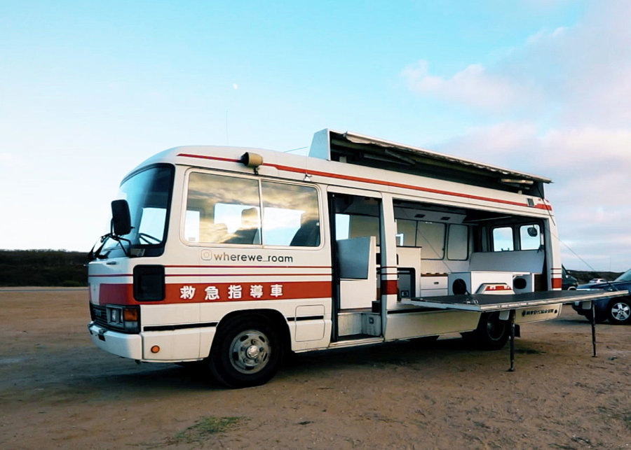 Jiro 1989 Ambulance Bus Conversion with Fold Down Performance Stage via Tiny Home Tours YouTube 003