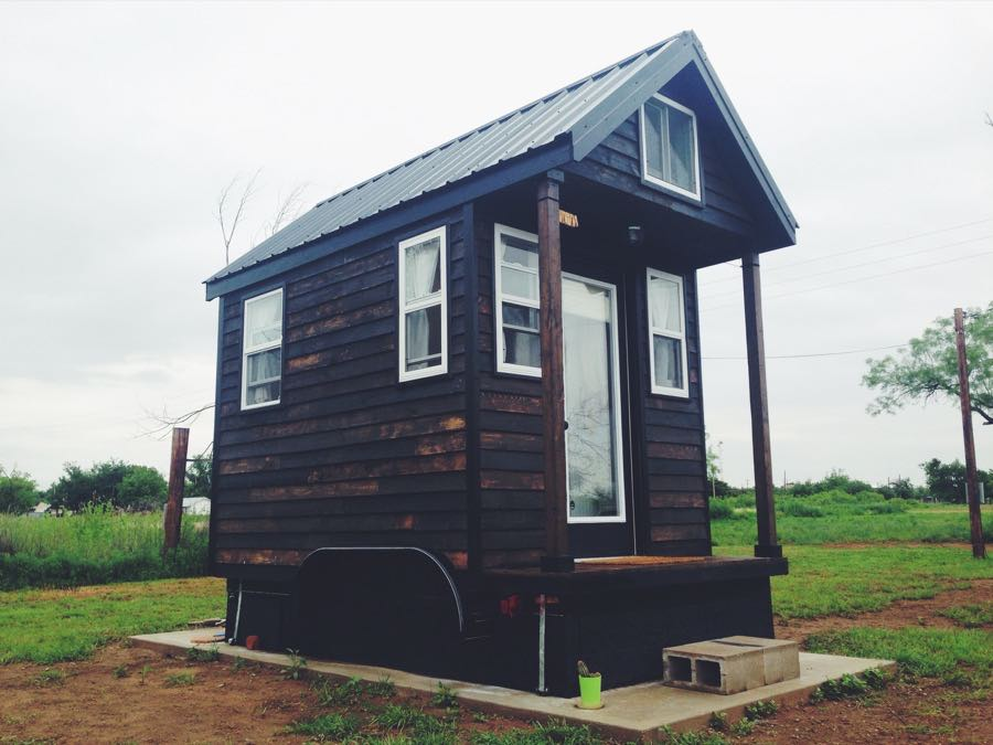 Man legally living in 84 sq ft tiny home in spur texas for Foundation tiny house builders