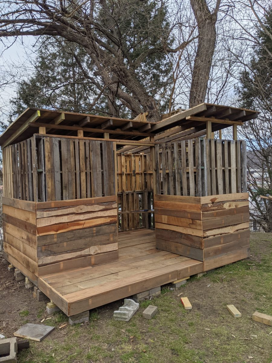 Dad Builds Son Nearly-Free Pallet Cabin 2