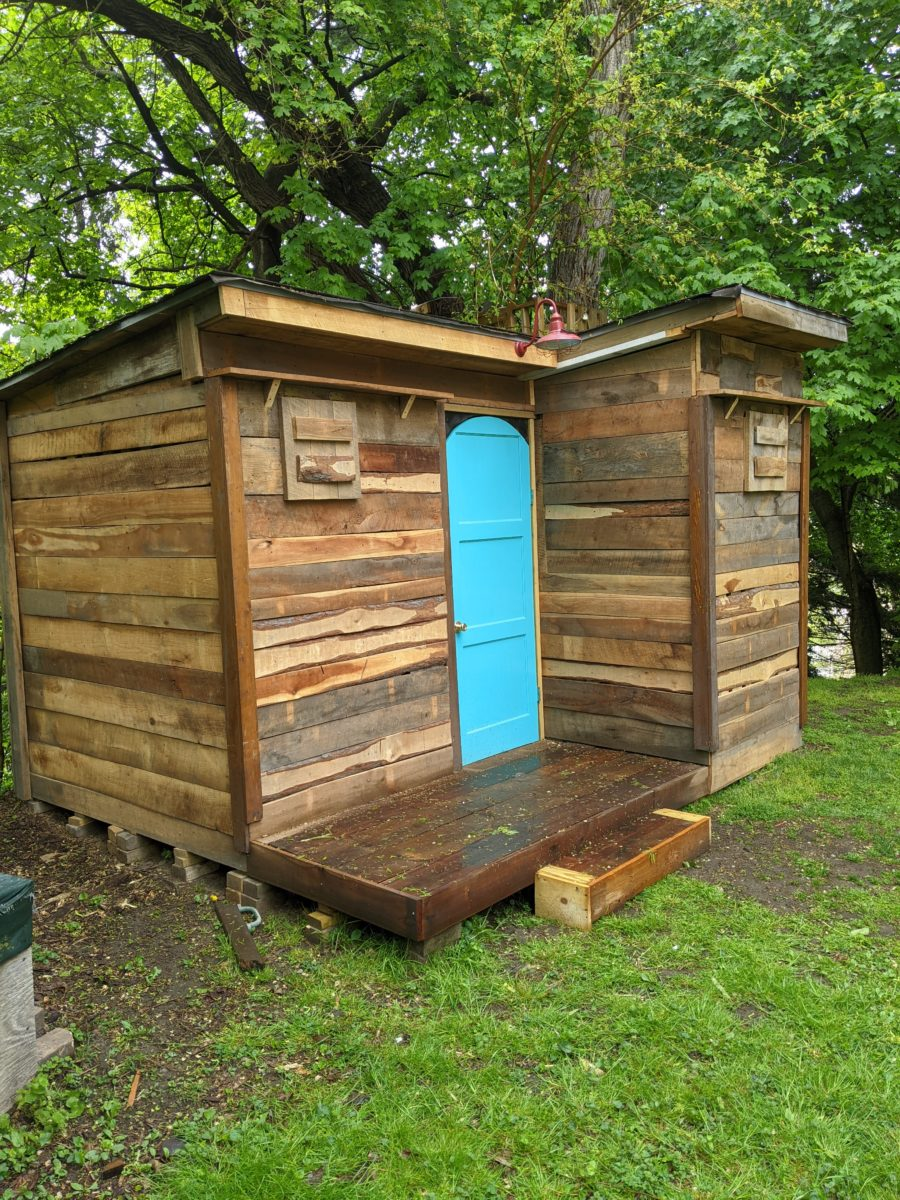 Dad Builds Son Nearly-Free Pallet Cabin 9