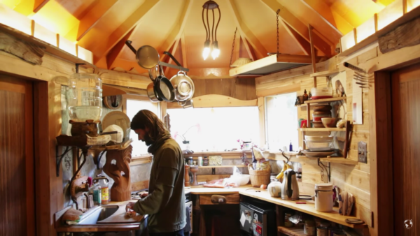 Artisan-Builds-His-Tiny-House-from-Salvaged-Trailer-with-No-Plans