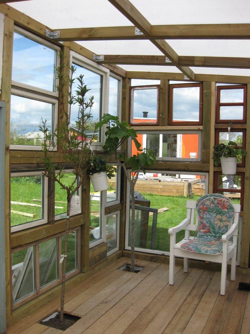 Backyard Tiny Hobby House Built from Recycled Windows