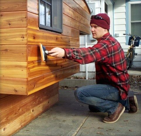 Peter Pavlowich Applying Finish on a Casual Turtle Camper