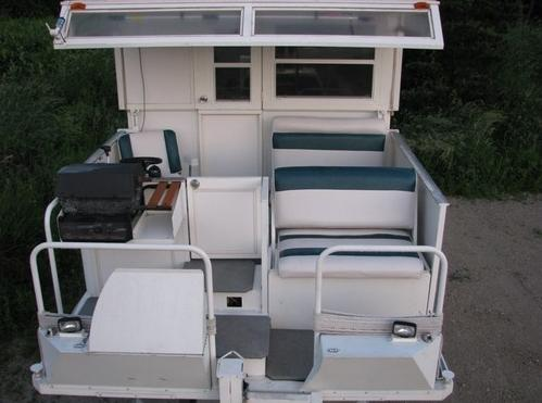 pipercraft-trailerable-houseboat-cockpit-grill-front-deck