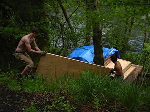 Prefab Tiny Cabin Panels Arrive at River