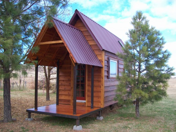 tall tiny house with a porch
