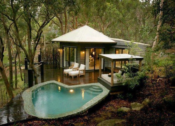Tiny cabin with deck and poolside cabana