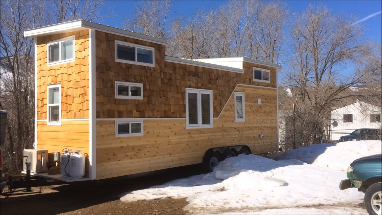28 39 tiny house on wheels built for a family of four for Small house design on wheels
