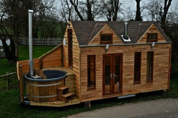 Mobile Tiny Cabin Built on a Trailer with Hot Tub for Glamping