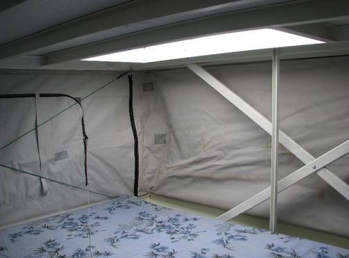 trailerable-houseboat-sleeping-pop-up-loft