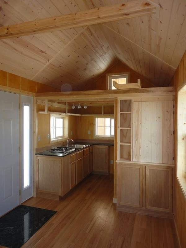 Kitchen, Loft, And Living Area - Father and son design/build the perfect 200-square-foot tiny cabin - Images © VastuCabin.com