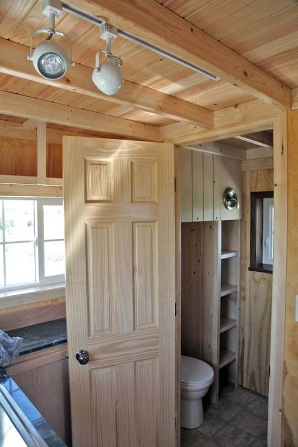 Father and son design/build the perfect 200-square-foot tiny cabin - Images © VastuCabin.com